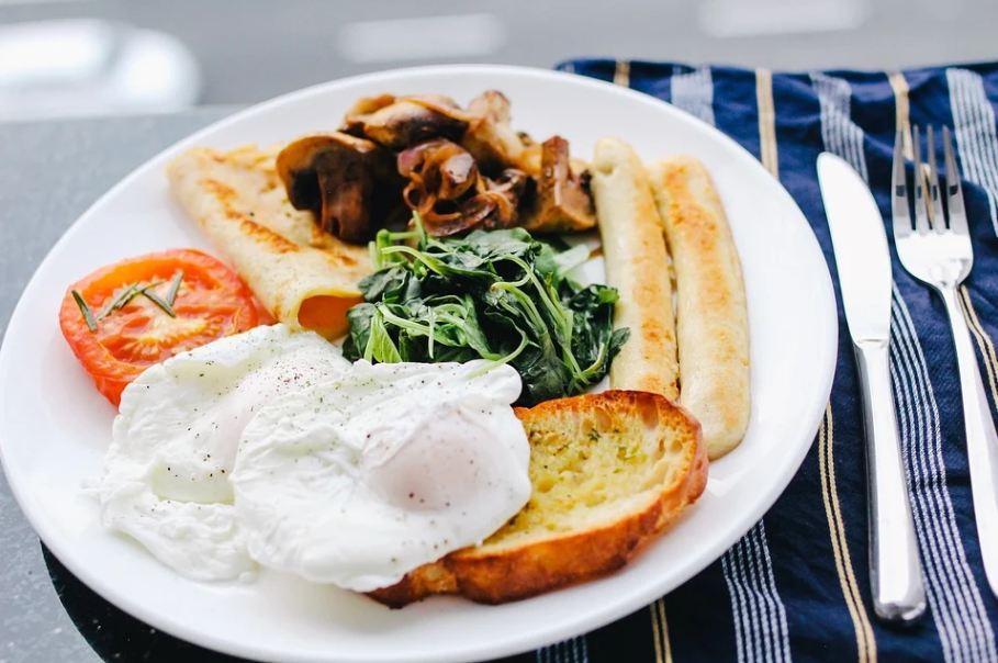 a plate having numerous breakfast items